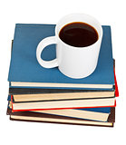 above view of mug of coffee on stack of books