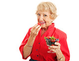 Fit Healthy Senior Lady Eating Berries