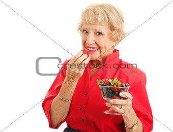 Fit Healthy Senior Lady Eating Berries
