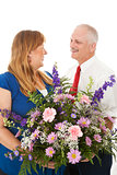 Husband Gives Flowers to His Wife
