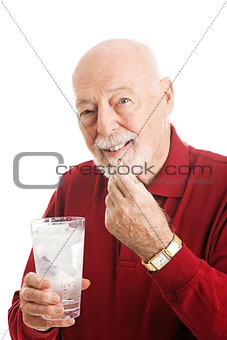 Senior Man Taking Fish Oil Capsule