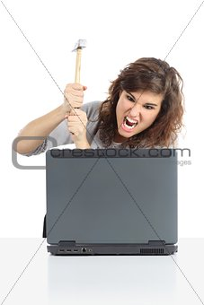 Angry woman ready to destroy a computer with a hammer