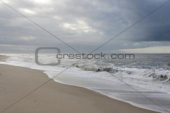 Beach with dark rain clouds