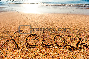 inscription Relax on the sand by the sea