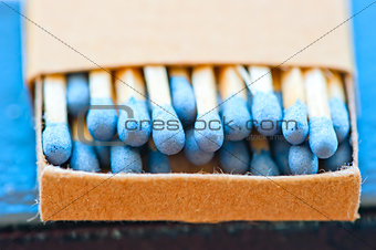 matchbox with blue heads closeup