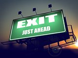 Exit Just Ahead on Green Billboard.