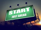Start Just Ahead on Green Billboard.