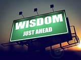 Wisdom Just Ahead on Green Billboard.