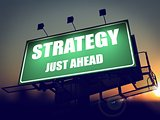 Strategy Just Ahead on Green Billboard.