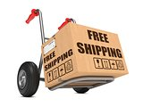 Free Shipping - Cardboard Box on Hand Truck.