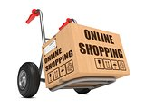 Online Shopping - Cardboard Box on Hand Truck.