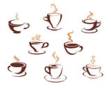 Set of steaming cups of hot beverages