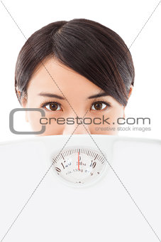 beautiful young woman holding scales