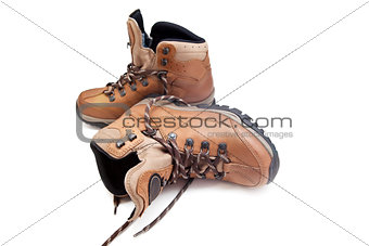 pair female hiking boots over white