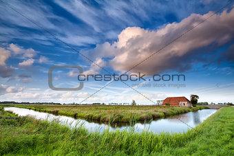 charming farmhouse and dramatic sky