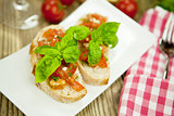 fresh tasty italian bruschetta with tomato on table