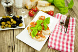 fresh tasty italian bruschetta with tomato on table