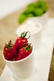 tasty tomatoes mazarella and basil on plate on table