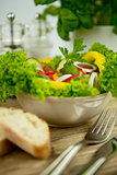 fresh tasty healthy mixed salad and bread on table