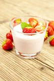 fresh tasty strawberry yoghurt shake dessert on table