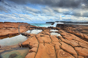 Waves splash on magnificent rock formations