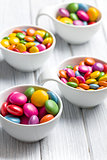colored candy in white bowl