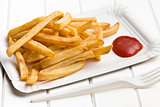 french fries with ketchup on paper plate
