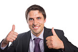 Close-up of a businessman gesturing thumbs up