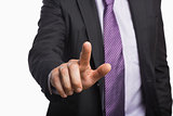 Businessman pointing against white background