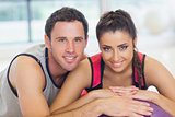 Young woman and man with cropped fitness ball at a gym