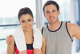 Close-up portrait of a fit couple in exercise room