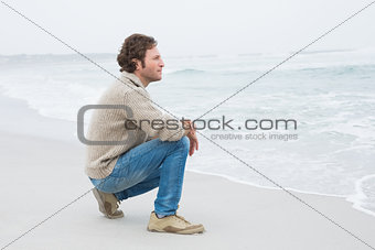 Side view of a casual young man relaxing at beach