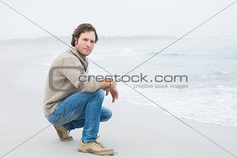 Portrait of a serious casual man relaxing at beach