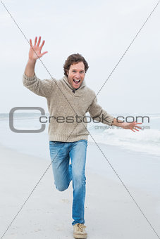 Full length of a casual man running at beach
