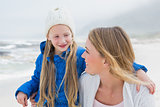 Girl with smiling mother at beach