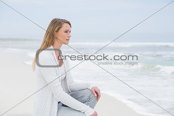 Casual young woman relaxing at beach