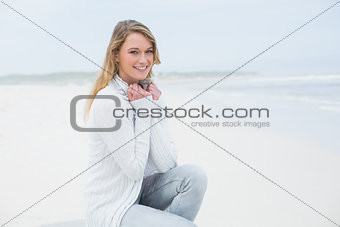 Smiling casual young woman relaxing at beach