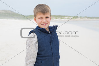 Portrait of a cute smiling boy at beach