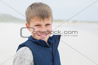 Close-up of a cute smiling boy at beach