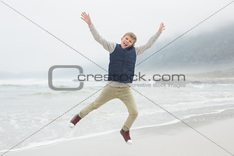 Full length of a boy jumping at beach