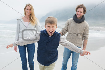 Happy family of three at the beach