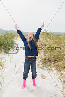 Full length of a girl shouting at beach