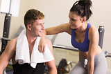Sporty man and woman chatting in gym