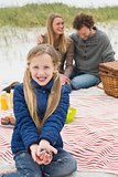 Happy family of three at a beach picnic