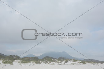 Beach against the misty mountains