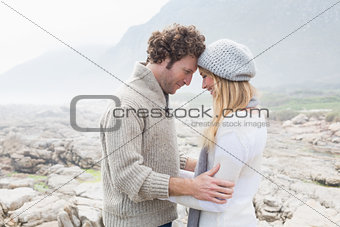 Romantic couple standing on a rocky landscape