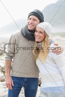 Young couple standing on a rocky landscape