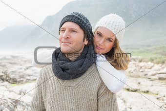 Romantic young couple together on a rocky landscape