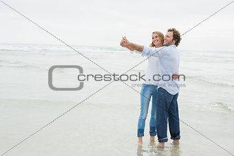 Young couple dancing at beach