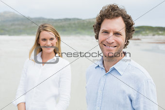 Smiling casual young couple at beach